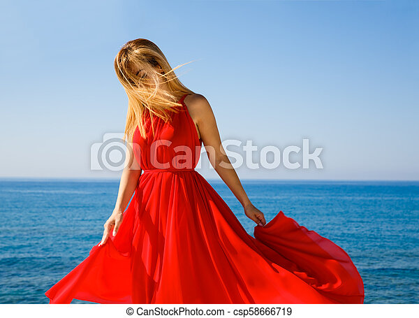 Blond woman in red - csp58666719