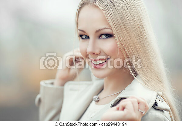 blond woman outdoor - csp29443194