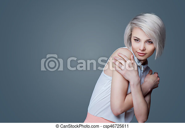 blond woman with brown eyes - csp46725611