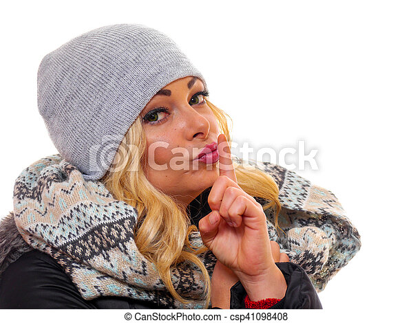 Blond woman with finger to lips. - csp41098408