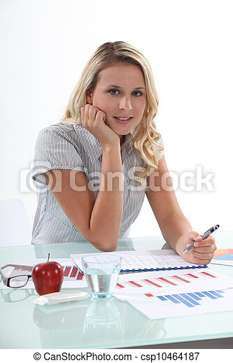 Blond woman working with financial graphs - csp10464187