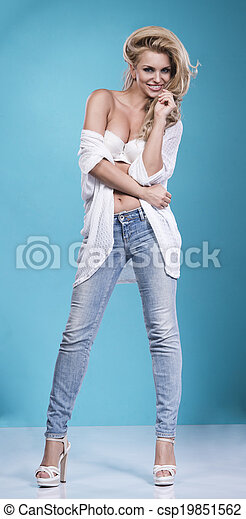 blonde beauty wearing sexy lingerie and jeans - csp19851562