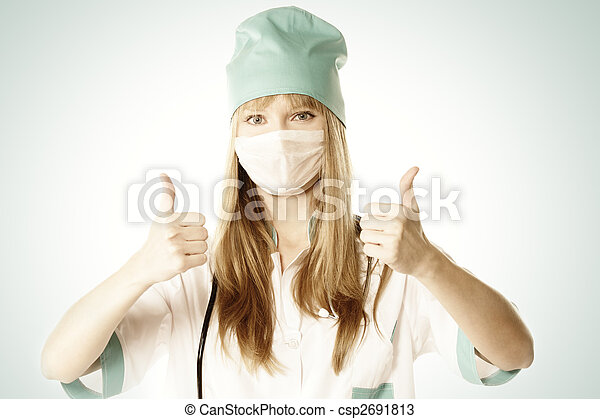 Blonde doctor with thumbs up - csp2691813