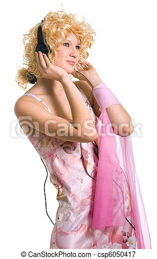 blonde girl in headphones - csp6050417