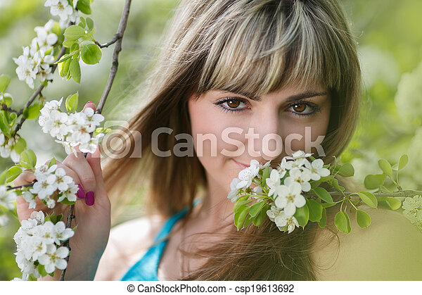 Blonde Girl with Cherry Blossom - csp19613692