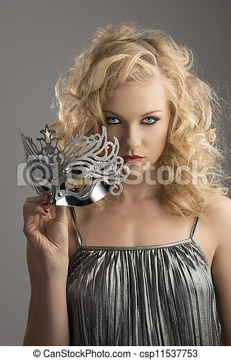 blonde girl with silver mask in front of the camera - csp11537753
