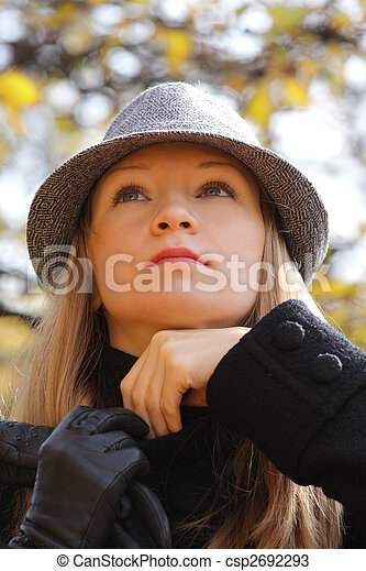 Blonde in hat adjusting sweater - csp2692293