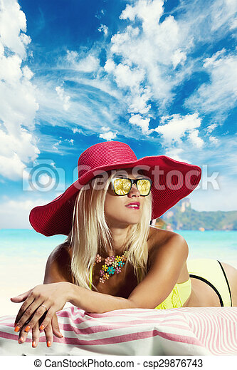Blonde woman in hat on the beach - csp29876743
