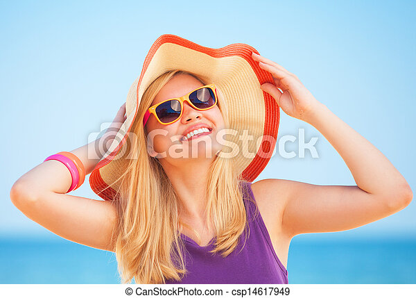 Blonde woman on the beach in spring time. - csp14617949
