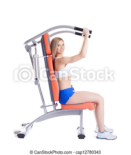 Blonde woman sitting on exerciser - csp12780343