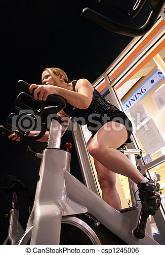 Blonde woman spinning in the gym. - csp1245006