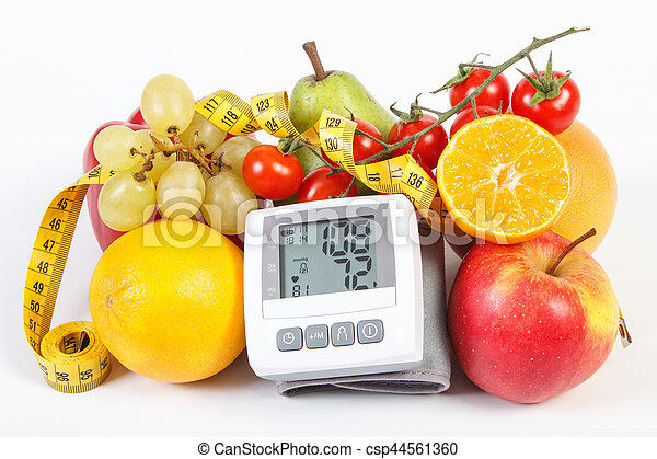 Blood pressure monitor with result of measurement, fruits with vegetables and centimeter, healthy lifestyle - csp44561360