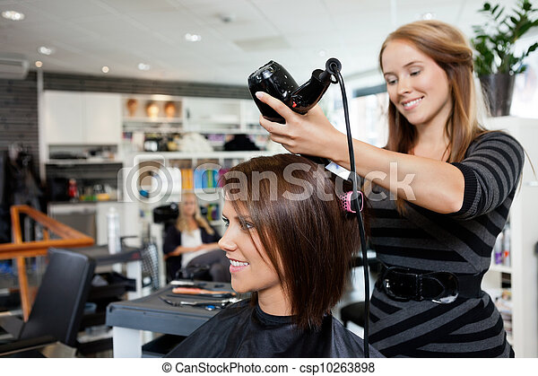 Blow Drying Hair After Haircut - csp10263898