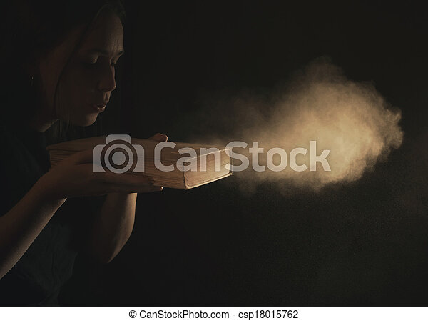 Blowing dust off Bible - csp18015762