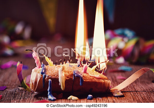 blowing out the candles of a cake - csp49243196