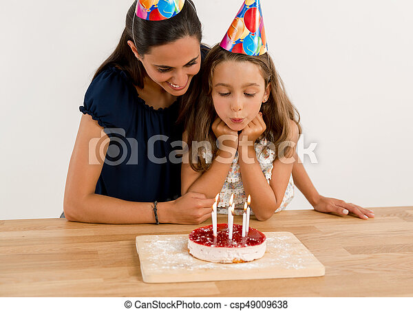 Blowing out the candles - csp49009638