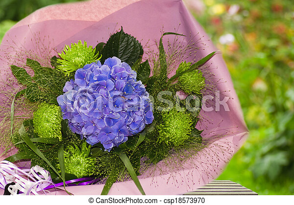 Blue and green bouquet of flowers wrapped in paper - csp18573970