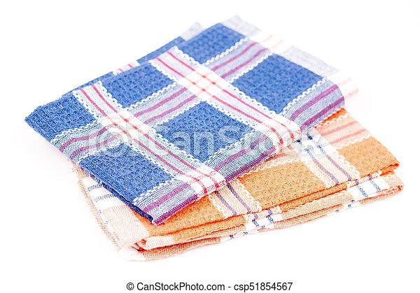 Blue and orange new kitchen dishtowels over white background - csp51854567