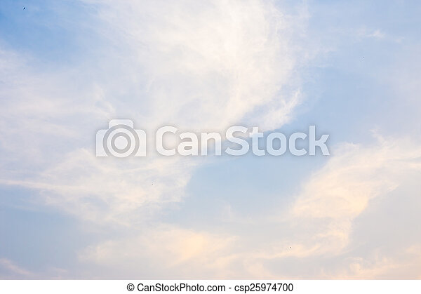 Blue and orange sky with clouds background - csp25974700