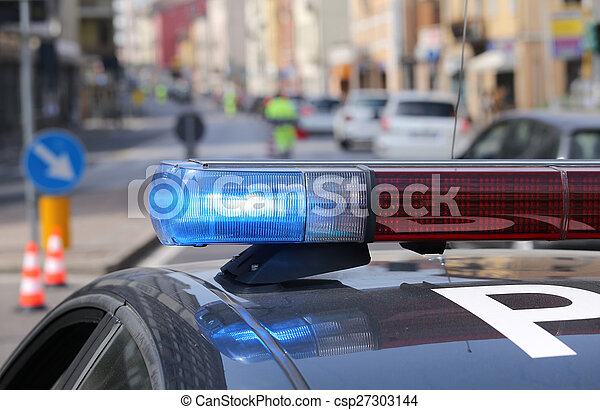 Blue and red flashing sirens of police car - csp27303144