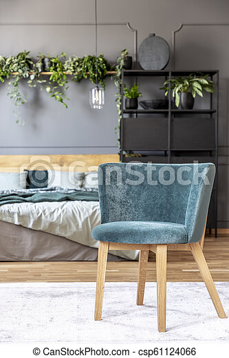 Blue Armchair On White Carpet In Grey Bedroom Interior With Wooden