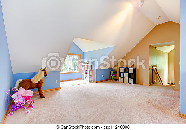Blue attic living room with toys and play area. - csp11246098