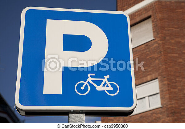 Blue bicycle parking sign in urban setting - csp3950360