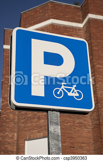 Blue bicycle sign in urban setting - csp3950363