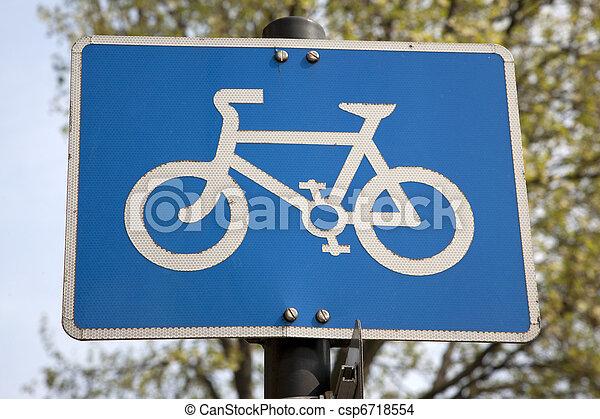 Blue Bike Lane Sign in Urban Setting - csp6718554