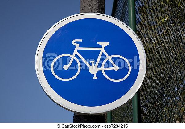 Blue Bike Sign in Urban City Setting - csp7234215