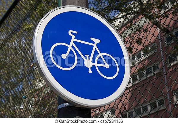 Blue Bike Sign in Urban Setting - csp7234156