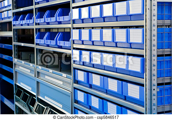 blue boxes on a stock bin in warehouse blue boxes on a stock bin in