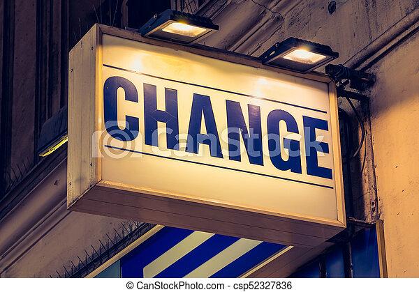 blue change signboard in a street of Paris - csp52327836