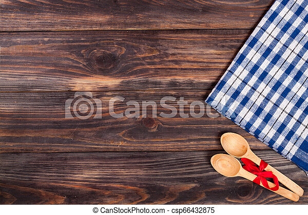 blue checkered tablecloth on the black wooden table with copy space for your text. Top view - csp66432875