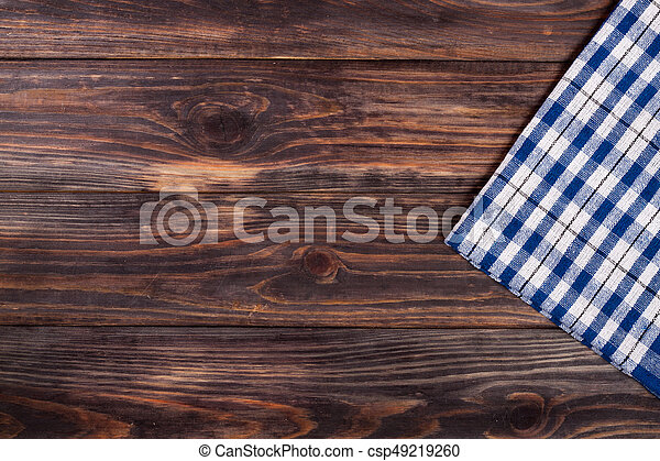 blue checkered tablecloth on the black wooden table with copy space for your text. Top view - csp49219260