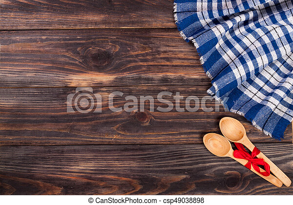 blue checkered tablecloth on the black wooden table with copy space for your text. Top view - csp49038898