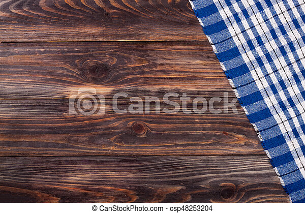 blue checkered tablecloth on the black wooden table with copy space for your text. Top view - csp48253204