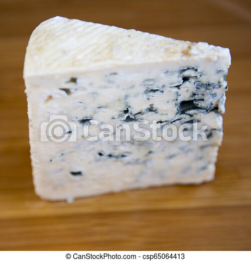Blue cheese on bamboo board, side view. Close-up. - csp65064413