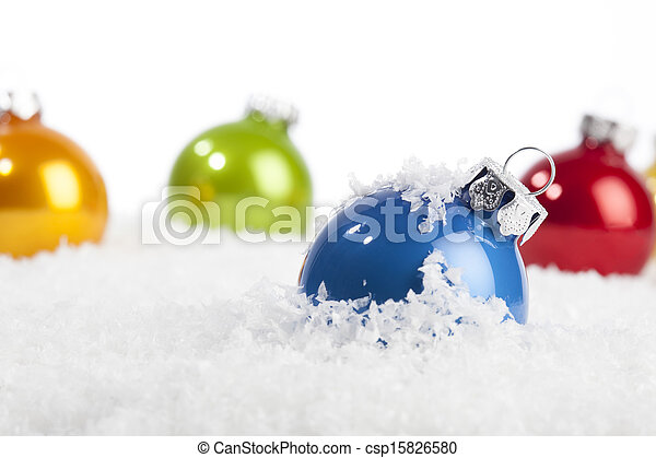 Blue Christmas bauble in decorative snow - csp15826580