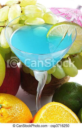 Blue cocktail among fruits - csp3716250