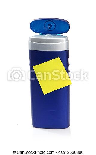 Blue cosmetic bottle isolated on white background - csp12530390