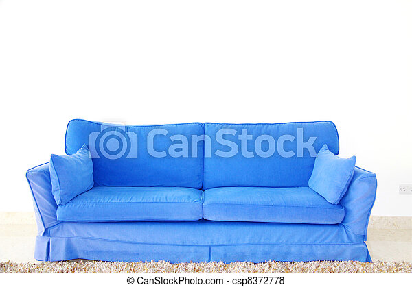 blue double sofa on a blank wall - csp8372778