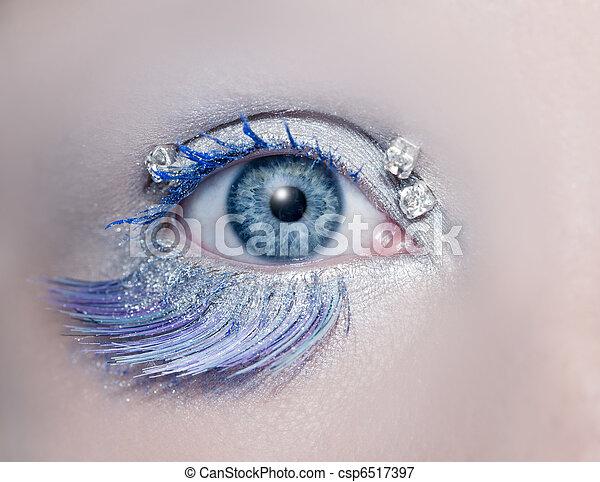 Blue eye macro closeup winter makeup jewels diamonds - csp6517397