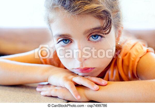 Blue eyes sad children girl crossed arms - csp7499786