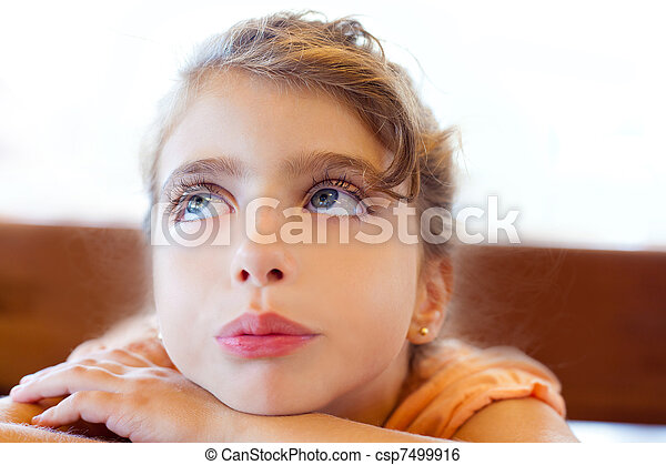Blue eyes sad children girl crossed arms - csp7499916