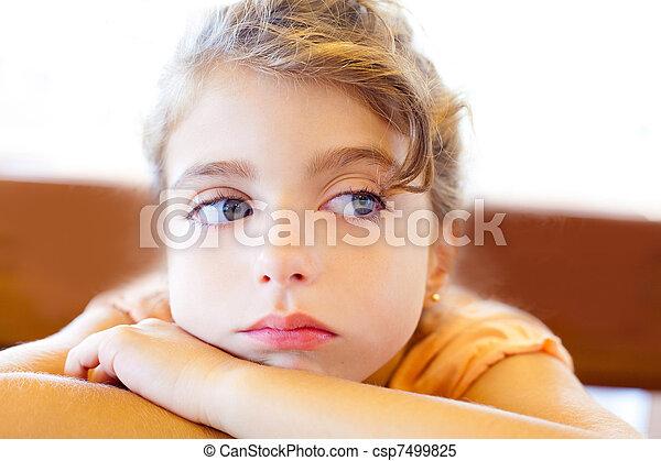 Blue eyes sad children girl crossed arms - csp7499825