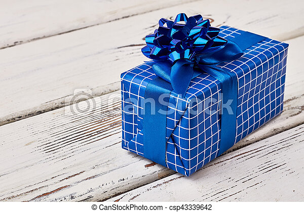 Blue gift box on wood. - csp43339642
