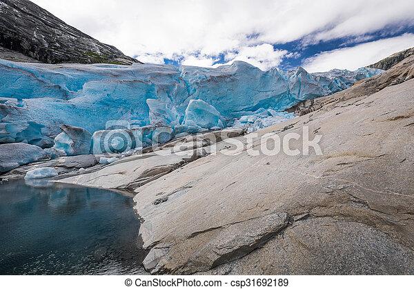 Blue glacier Nigardsbreen in Norway - csp31692189
