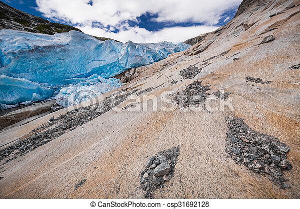 Blue glacier Nigardsbreen in Norway - csp31692128