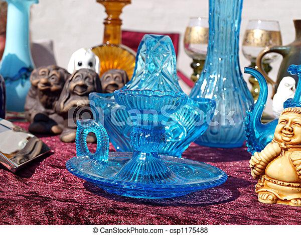 Blue glass items in a flea market - csp1175488